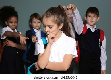 Children bullying their classmate on color background