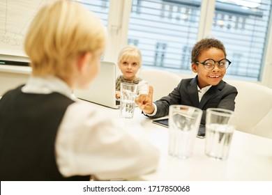 Children as businessmen negotiating a multicultural joint venture