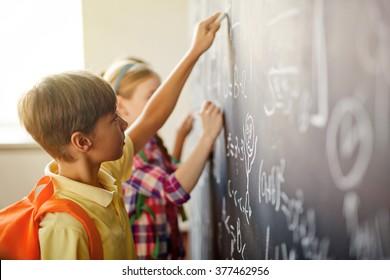 Children by blackboard