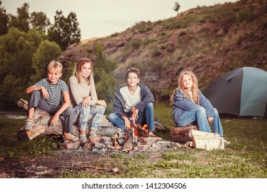 Children in the camp by the fire