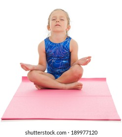 Children can do yoga too! This 4 year old girl is demonstrating the Dhyana yoga position which is a meditation position. She has her legs crossed and rests her hands on her knees.