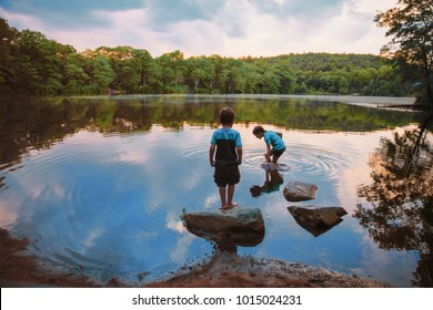 children caught fish in the lake. boys playing near the water