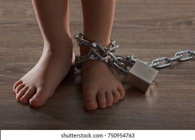 Children with chain tied, imprison, retarded, Child Abuse on black abstract concept