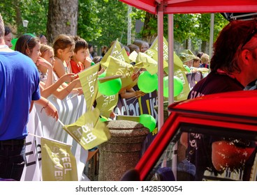 """Children cheering and waving """" I Feel sLOVEnia"""" flags at departure of Tour of Slovenia stage one race, Ljubljana, Slovenia - June 19, 2019"""