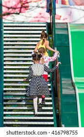 Children climb the stairs