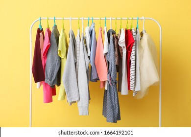 Children clothes on a hanger on a colored background. Children's clothing, children's shopping.