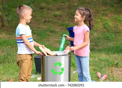 Children collecting garbage outdoors. Recycling concept
