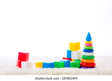 children colored cubes on a white background