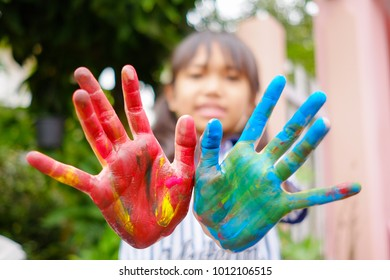 Children colored hands dirty