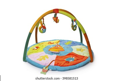 children  colorful play mat, with different toys  isolated on a white background