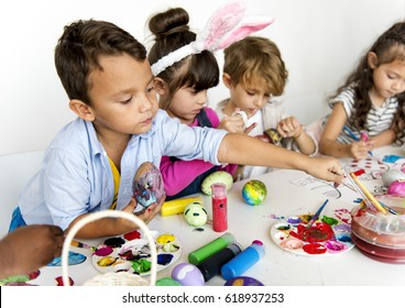 Children Coloring Easter Eggs Concept