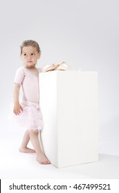 Children Concepts and Ideas. Little Cute Caucasian Girl Poses With Miniature Pointes. Against White. Vertical Image Orientation