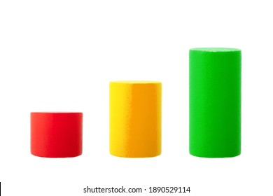 children constructor will line up wooden multicolored cylinders in ascending order in the form of a graph of growth and stabilization of the situation, objects isolated on a white background, nobody.