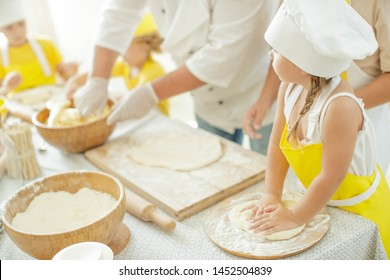 Children cook in the kitchen. A happy child learns to cook delicious food in the kitchen.