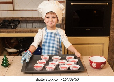 Children cooking Christmas cakes