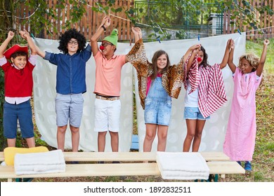Children in costume at the end of the talent show in the holiday camp are happy about the performance