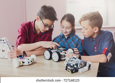 Children creating robots at school, stem education, copy space. Early development, diy, innovation, modern technology concept