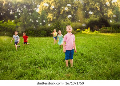 Children are delighted watching the soap bubbles