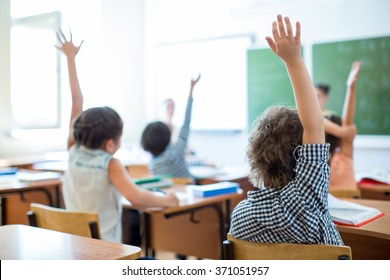 Children at a desk in classroom