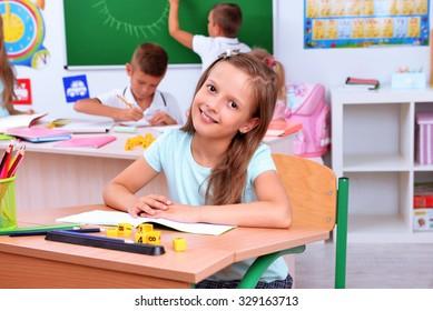 Children at the desks in classroom