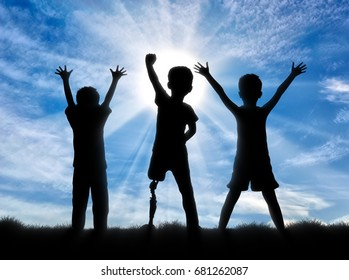 Children with disabilities in society concept. Happy disabled boy with a prosthetic leg standing among his friends, on sky background