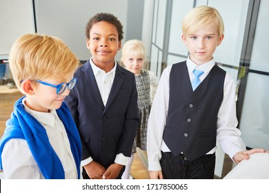 Children disguised as business people as multicultural business team