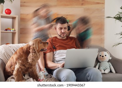 Children disturbing overwhelmed man in living room. Working from home during quarantine