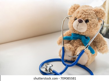 Children doctor concept - Teddy Bear with stethoscope. copy space