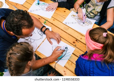 Children draw on white paper. View from above