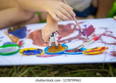 Children draw in summer park. Art concept