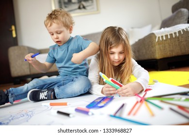 Children are drawing with colorful crayons and having fun