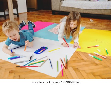 Children are drawing with colorful crayons and having fun one with each other.
