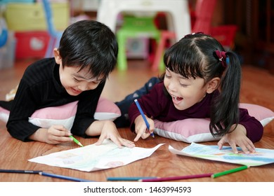 Children drawing and painting color on her paper with happiness. Education and little artist concept.