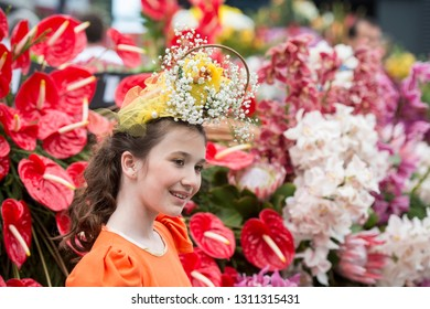 children dressed in colorful clothes at the Festa da Flor or Spring Flower Festival in the city of Funchal on the Island of Madeira in the Atlantic Ocean of Portugal.  Madeira, Funchal, April, 2018