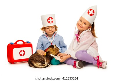 Children dressed at whites bandage paw to a cat