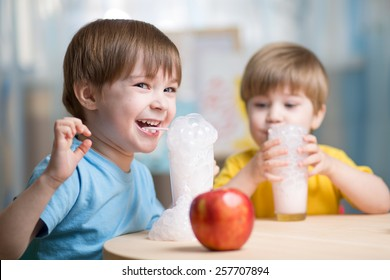 children drinking milk and having fun at home