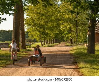 Children driving bike and gokart