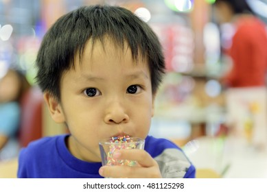 Children eating candy. Little boy eating chicle.