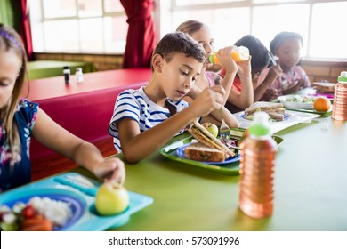 Children eating at the canteen at school