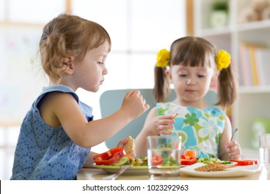 children eating food in daycare centre or home