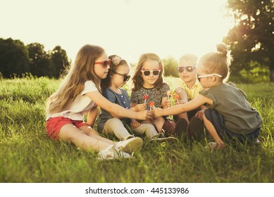 Children eating lollipops during summertime fun