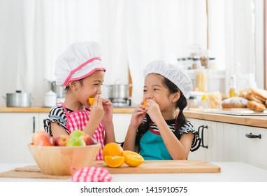 children eats fruit in kitchen having happy with good food healthy.