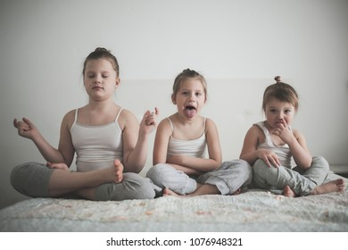 children and emotional fun yoga, the concept of children, a healthy lifestyle. Real interior, light tone and lifestyle, toning
