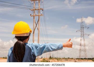 children engineer standing at electricity station, Her dream was to become an engineer and she has a thumbs up
