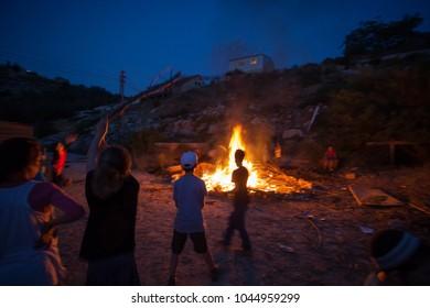 Children enjoying a bonfire on the occasion of Jewish festival of Lag ba'omer