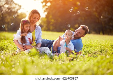 Children enjoying in making soap bubbles outside
