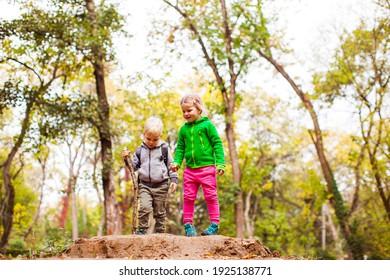 Children enjoying nature in the autumn park