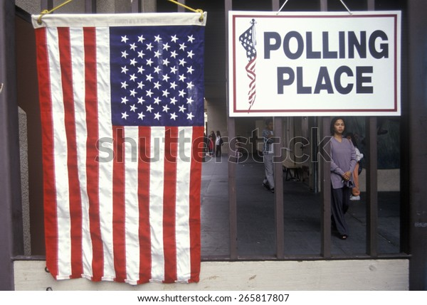 Children at the entrance to a polling place, CA