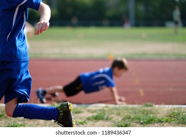 Children exercising on the sports field
