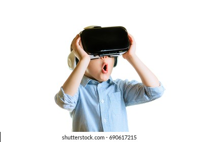 Children experiencing virtual reality isolated on white background. Surprised little boy looking in VR glasses.